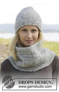 """Emmie Gray - Knitted DROPS hat and neck warmer with herringbone pattern in """"Cloud"""" or """"Eskimo"""". - Free pattern by DROPS Design"""