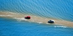This road in France disappears underwater twice a day. This dangerous road of connects the Gulf of Burnёf with the island of Noirmoutier,. Dangerous Roads, Red Beach, France Travel, Underwater, Dubai, Tourism, Adventure, Landscape, Viajes