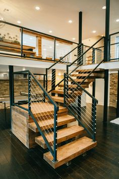 New steel and cable railings with wood stairs. Transforms space into open, rustic modern. #bunkerplans
