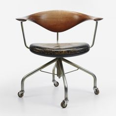 Hans Wegner Swivel Desk Chair from 1955. Danish furnitures are great and mostly very 'clean' and classic in design.  The is a museum for Hans Wegner in the old water tower in Tønder in the southwest corner of the country.