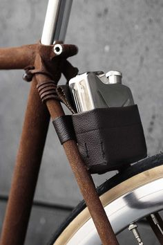 Bicycles: I love this raw wood fixie bike frame with leather flask holder.