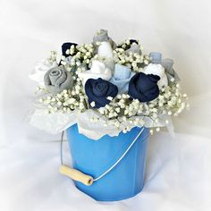 A perfect gift or centerpiece for a baby shower or new mom gift. Easy to follow tutorial to make a sweet Baby Socks Rose Bud Flower Bouquet.