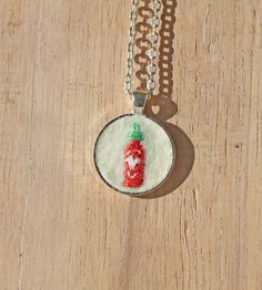 Could this be the world's smallest #Sriracha bottle?!?  // Embroidered Sriracha Pendant Necklace