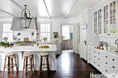 kitchen wall to ceiling tiles and simple ceiling.   Like brass too.