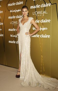 Irina Shayk Beaded Dress Irina Shayk wore an ultra-glamorous beaded gown with a long train and hip-high slit for the Marie Claire Prix de la Moda Awards. Brand: Elie Saab
