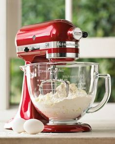 Love my Kitchen Aid  Mixer - hope to upgrade to this cherry apple red someday...