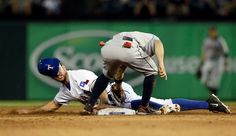Under the tag -  The Texas Rangers' Adam Rosales steals second under the attempted tag of Houston Astros' Jose Altuve in the fourth inning on Aug. 5 in Arlington, Texas. The Rangers won 4-3. - © Tony Gutierrez/AP