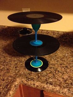 old records and cups = cake stand