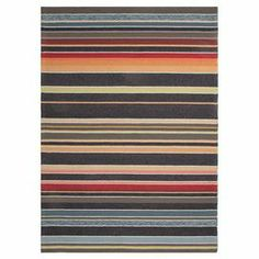 """Stylishly anchor your living room or master suite with this delightful hand-hooked rug, showcasing a handsome graphite blue and charcoal stripe motif.   Product: RugConstruction Material: Polypropylene and latexColor: Blue graphite, charcoal, red and greenFeatures:  Durable Hand-hookedLatex backing Suitable for indoor or outdoor usePile Height: 0.25"""" Note: Please be aware that actual colors may vary from those shown on your screen. Accent rugs may also not show the entire pattern that the…"""