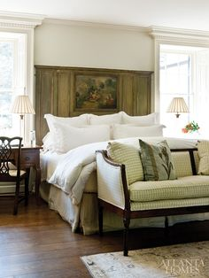 antique screen used as headboard set against crisp white linens (and checked settee is a nice add as well)