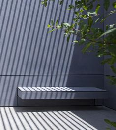 Bench integrated in facade. Jacobs Yaniv architects. EQUITONE facade materials…
