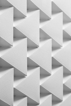 The grid inspires pattern in architecture. Form form that it takes doesn't necessarily have to be a square. The continuous arrangement of large and small triangles fabricate the pattern here.