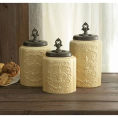 New 3 PC Canister Set with Fleur De Lis Lids. This is a Beautiful Canister set with Decorative lids. Due to the glazing process the color may vary from canister to canister. The canister is made out of ceramic. Ceramic Canister Set, Kitchen Canister Sets, Vintage Canister Sets, Creations, Ceramics, Antiques, Home Decor, Kitchen Ideas, Kitchen Redo
