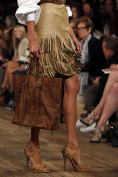 Sexy fringe skirt and great handbag