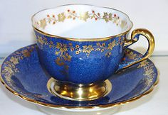 Royal Chelsea Cobalt footedTea cup & Saucer. Gold garland with elevated red beading.
