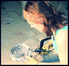 "This is a photo of me cutting metal for my flowers, circa 2012. It's a testament to how my definition of success has changed over the years since I began my business that summer. It's a photo of me doing what I truly love - making my art. See my #blogpost about how my early efforts at ""success"" underwent many changes over the years. Read it here:  #smallbusiness #art #etsyartist #artinprogress #businesswoman"