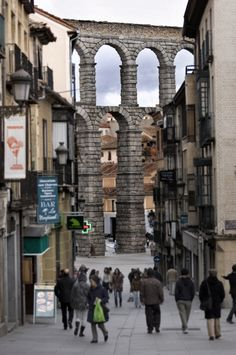 The Roman Aqueduct of Segovia, Spain. How cool having this running through your town.