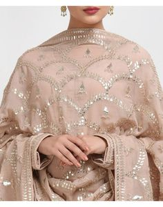 From our Wedding and Bridal Collection, this is an oyster pink pure crepe suit with intricate exquisite silvery gold gota patti and gold dabka work hand embroidery. The gota patti embroidered on the shirt at front-back neckline and sleeve ends. Shadi Dresses, Pakistani Formal Dresses, Pakistani Outfits, Indian Dresses, Indian Outfits, Embroidery Suits Design, Embroidery Designs, Beaded Embroidery, Hand Embroidery