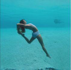 Mermaid Yoga.What is behind her?