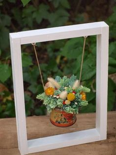 Could do this with stained glass suncatcher. Hang from frame?