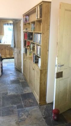 beautiful bespoke pine Welsh dresser, that is being used as a bookcase: http://www.pinewelshdressers.co.uk/