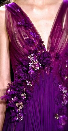 Love this purple dress with floral accents!