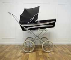 This is similar to the baby buggy my mom used for us when we lived in New York.  She walked everywhere and could keep us bundled up. Cozy warm. I loved it. It came with us to California and I would put my dolls in it. It was huge and I think ours was green.