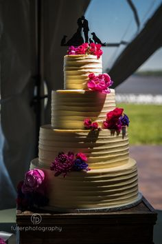 A cake with a vibrant pop of color is the perfect addition to this bohemian style wedding. Fuller Photography