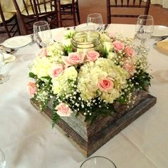 Barn wood box centerpiece with mason jar candle holder. White hydrangea, pink spray roses and baby's breath. Rustic wedding centerpieces by Chester's Flower Shop in Utica, NY by dora Wood Box Centerpiece, Mason Jar Centerpieces, Mason Jar Candles, Centerpiece Flowers, Rustic Centerpieces, Floating Candles, Unique Wedding Centerpieces, Unique Weddings, Wedding Decorations