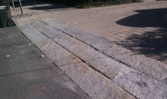 Curb stone apron for driveway stone Stone Driveway, Driveway Ideas, Curb Stone, Driveway Apron, Pavement, House Front, Granite, Sidewalk, New Homes