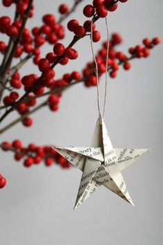 With December right around the corner, fold book pages into festive ornaments and hang them from your pine tree decor. | See more wedding origami and folded paper details: http://www.mywedding.com/articles/wedding-origami-and-folded-paper-details/