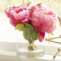 Craft a charming entryway vignette or dining table centerpiece with this lovely faux peony arrangement, showcasing pink blossoms nestled in a round glass vase. Hydrangea Vase, Peonies And Hydrangeas, Silk Peonies, Peonies Bouquet, Bouquets, Peony Arrangement, Peonies Centerpiece, Orchid Arrangements, Floral Centerpieces