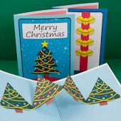 Craft project: Instructions and patterns for making Christmas cards with a Christmas tree pop-up inside.
