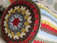 Bolster pillow - ends are slightly modified version of crochetingwithraymond's granny mandala, link here: http://crochethealingandraymond.wordpress.com/2010/11/11/revisiting-the-granny-mandala/  #crochet #pillow #bolster