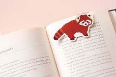 This ridiculously cute magnetic book mark. | 21 Things You Need If You Love Red Pandas