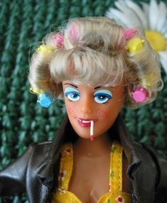 Most Humorous Retro Inspired Image: Trailer-trash Barbie. Sorry, but that's funny!