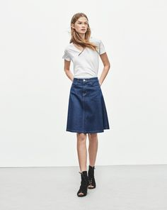 "New! Did you know you can now find out how every garment was made? Click the ""Who Made It"" Tab. <br /><br /> Feminine A-line shaped denim skirt with a slightly below knee length. Raw, blue 10,5 oz denim that has a elementally minimalist look to it, maki"
