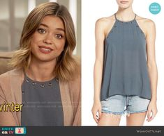 Haley's blue top with grommet trim on Modern Family. Outfit Details: https://wornontv.net/66015/ #ModernFamily