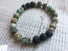 Items similar to Natural Gemstone bracelet, African turquoise, labradorite and lava stone diffuser bracelet, diffuser jewelry on Etsy Diffuser Jewelry, Stone Beads, Labradorite, Natural Gemstones, Mother Nature, Lava, Barefoot, Im Not Perfect, Beaded Bracelets