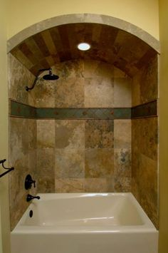 Barrel ceiling over bathtub with tile above