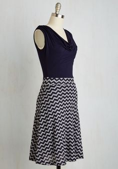 Stacks of beautiful boxes are all set out on the counter, and clad in this tank dress, you make quick work of addressing them! With a ribbed knit skirt in navy and ash grey, and a jersey knit top with a classic cowl neck, this twofer dress is deserving of a stylish stamp of approval.