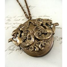 LOCKET Necklace Double Dragon Large Midevil Locket ❤ liked on Polyvore