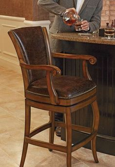 Line your bar or counter with the Barrington Swivel Bar Height Bar Stool that adds handsome