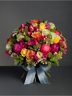 Wild At Heart - Pimms O'Clock Bouquet - Inspired by our favourite summer drink, our Pimms bouquet is a bright mix of orange and green roses and peonies.
