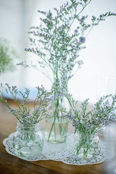 Sprigs of Misty Blue inside different sized jars come together for a simple, yet elegant centerpiece. Shop Misty Blue and other popular wedding flowers and fillers year-round at GrowersBox.com!