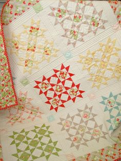 sparkling starbursts pattern by denise sheehan. strawberry fields fabric by fig tree quilts.