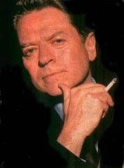 Robert Palmer (1949 - 2003), the rock singer who died way too young of a heart attack at the age of only 54.