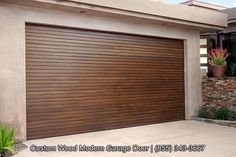 Custom designed modern wood garage doors with horizontal, staggered wood slat design. Sectional, automatic garage doors made in Los Angeles! by DynamicGarageDoors