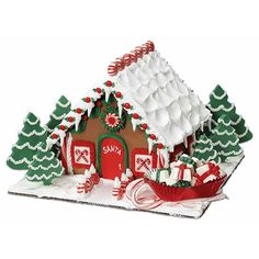Santa Calls It Home Gingerbread House - What a great place to relax for the holidays! Make Santa's little getaway with our Pre-Baked Gingerbread House Kit, Christmas tree cookie evergreen and a sweet sleigh made from Red Foil Petite Loaf Cups. Gingerbread House Designs, Gingerbread House Parties, Gingerbread Village, Christmas Gingerbread House, Christmas Tree Cookies, Christmas Sweets, Christmas Goodies, Christmas Baking, Christmas Holidays