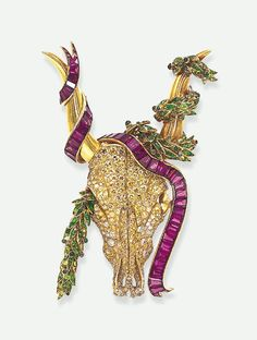AN IMPORTANT DIAMOND AND GEM-SET LONGHORN BROOCH, BY BOIVIN   The sculpted and pierced pavé-set diamond and yellow diamond longhorn head, extending polished gold horns, each adorned by a cascading calibré-cut purple sapphire ribbon and an articulated calibré-cut demantoid garnet and cabochon emerald laurel garland, mounted in gold, circa 1940